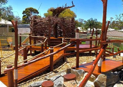Nature wood playground with nest and rocks